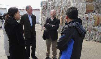 FILE - In this April 7, 2013 file photo provided by Gov. Dennis Daugaard's office, South Dakota Gov. Dennis Daugaard, center left, and Jake Anderson, right, owner and president of Millennium Recycling in Sioux Falls, speaks with Chinese officials at a recycling center in Beijing. Daugaard will be joined by representatives from 11 companies and groups from around South Dakota when he makes his third trade mission to China May 9-16, 2014. (AP Photo/Gov. Dennis Daugaard's Office, Kelsey Webb, File)