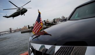 The American Flag on the hood of President Barack Obama and first lady Michelle Obama's motorcade vehicle is seen as they land at the Wall Street Landing Zone in Marine One, Friday, April 11, 2014, in New York, as they travel to the Al Sharpton's National Action Networks 16th Annual Convention. (AP Photo/Carolyn Kaster)