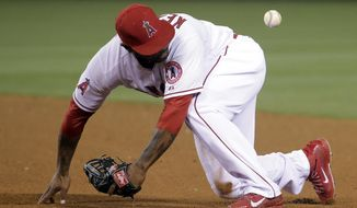 Los Angeles Angels second baseman Howie Kendrick is unable to get a glove on the single by New York Yankees' Jacoby Ellsbury during the eighth inning of a baseball game in Anaheim, Calif., Wednesday, May 7, 2014. (AP Photo/Chris Carlson)