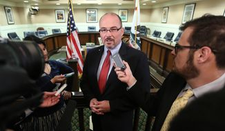 "FILE -- In this April 28, 2014 file photo, Assemblyman Tim Donnelly, R-Twin Peaks, a Republican gubernatorial candidate, talks with reporters at the Capitol in Sacramento, Calif.  Republican Congressman Darrell Issa has condemned comments by Donnelly in which he has tried to tie his Indian-American opponent, Republican Neel Kashkari, to fundamentalist Islamic law.  Issa said Thursday the comments and post on social media are ""hateful and ignorant garbage.""(AP Photo/Rich Pedroncelli,file)"