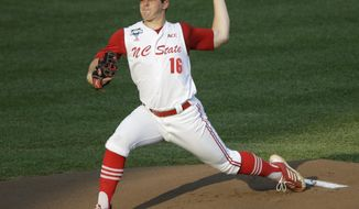 FILE - In this June 20, 2013 file photo, North Carolina State pitcher Carlos Rodon throws against North Carolina during an NCAA College World Series elimination baseball game in Omaha, Neb. (AP Photo/Nati Harnik, File)