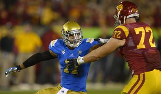 FILE - In this Nov. 30, 2013, file photo, UCLA linebacker Anthony Barr, left, tries to get by Southern California offensive tackle Chad Wheeler during the first half of an NCAA college football game in Los Angeles. Barr moved from offense to defense after two years in college and finished with 23 1/2 sacks in two seasons playing outside linebacker in 3-4 defense. He is a top prospect in the upcoming NFL draft. (AP Photo/Mark J. Terrill, File)