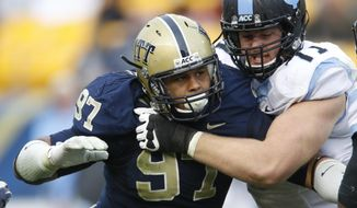 FILE - In this Nov. 16, 2013, file photo, Pittsburgh defensive lineman Aaron Donald (97) in action in an NCAA football game between Pittsburgh and North Carolina in Pittsburgh. Donald is a top prospect in the upcoming NFL draft. (AP Photo/Keith Srakocic, File)
