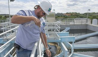 ADVANCE FOR WEEKEND USE, MAY 10-11 AND THEREAFTER - In this MAy 2, 2014 photo, Curtis Jeffrey, lead operator at the West Travis Water Treatment Plant, tests water quality in West Travis, Texas. The West Travis County Public Utility Agency wants to expand water holdings to supply a dozen or so subdivisions.   (AP Photo/Austin American-Statesman, Austin Humphreys)  AUSTIN CHRONICLE OUT, COMMUNITY IMPACT OUT, INTERNET AND TV MUST CREDIT PHOTOGRAPHER AND STATESMAN.COM