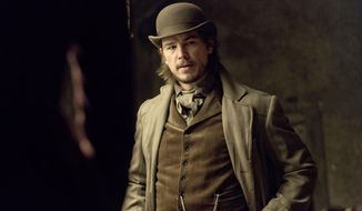 """This photo released by Showtime shows Josh Hartnett as Ethan Chandler in season 1 of """"Penny Dreadful."""" Hartnett plays a troubled American, a gun for hire, ensnared by Victorian London's dark side in the horror drama-cum-psychological study premiering Sunday.  (AP Photo/Showtime, Jonathan Hession)"""