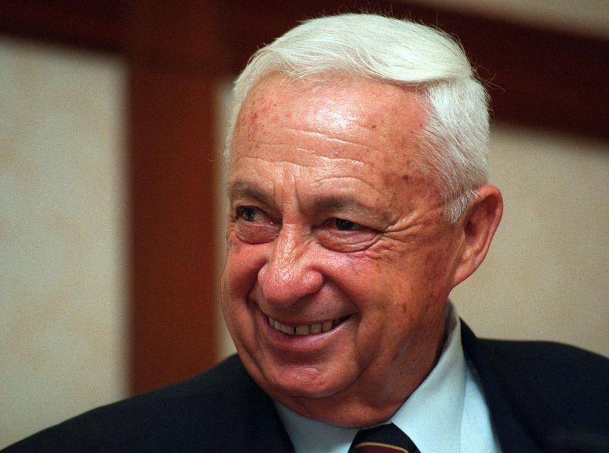 Likud party leader Ariel Sharon smiles as he speaks to the Foreign Press Association in Jerusalem Tuesday August 1, 2000. Sharon said Tuesday that the concessions Israeli Prime minister Ehud Barak is willing to make in Jerusalem in a final peace agreement with the Palestinians, are dangerous and would not constitute genuine peace. (AP Photo/Jacqueline Larma)