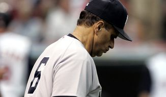 New York Yankees manager Joe Torre walks to the mound to take out pitcher T.J. Beam in the fifth inning in baseball action, Tuesday, July 4, 2006, in Cleveland.  (AP Photo/Tony Dejak)