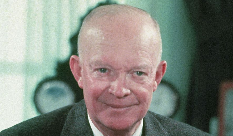 ** FILE ** In this 1956 file photograph, President Dwight Eisenhower is seen at his desk in the White House in Washington.  (AP Photo/File)