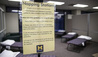 ADVANCE FOR MONDAY, MAY 12- In an April 29, 2014 photo, a napping station implemented at the Shapiro Undergraduate Library at the University of Michigan in Ann Arbor, Mich., is seen. For students looking to get a quick nap in between exam preparations but who live too far away to do so, the new napping station could be the best alternative. (AP Photo/The Michigan Daily, Allison Farrand)