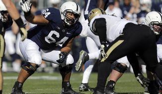 FILE - In this Nov. 16, 2013, file photo, Penn State guard John Urschel (64) lines up during the first quarter of an NCAA college football game against Purdue in State College, Pa. Urschel will routinely provide a look at his journey leading to the NFL draft on May 8, 2014, in a series of diary entries. (AP Photo/Gene J Puskar, File)