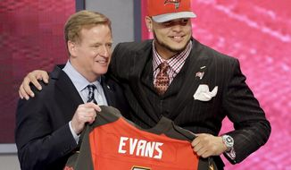 Texas A&M wide receiver Mike Evans poses with NFL commissioner after being chosen by the Tampa Bay Buccaneers as the seventh pick in  the first round of the 2014 NFL Draft, Thursday, May 8, 2014, in New York. (AP Photo/Frank Franklin II)