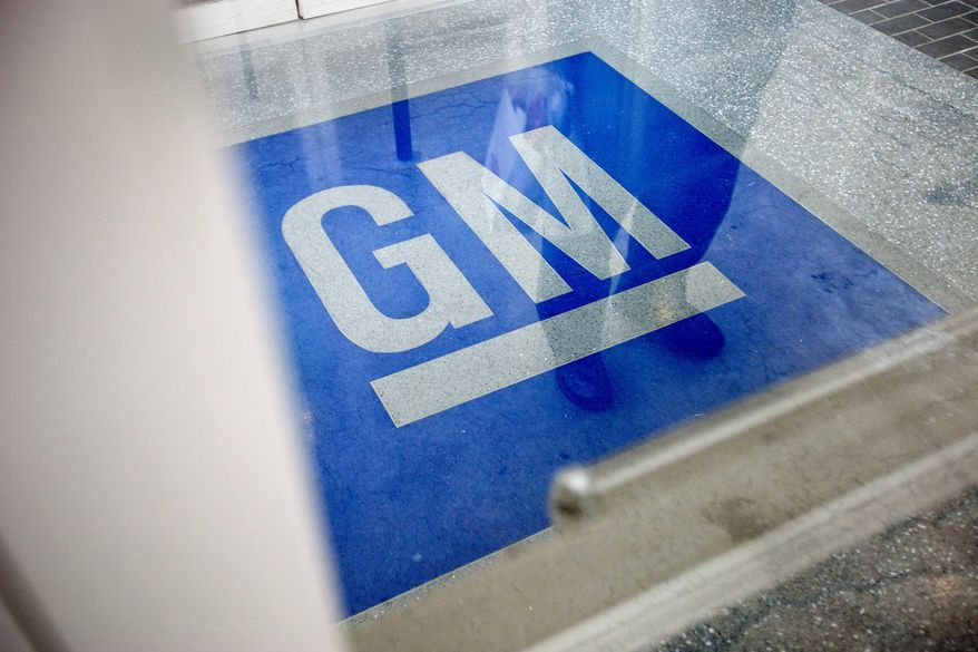** FILE ** In this Thursday, Jan. 10, 2013, file photo, the logo for General Motors decorates the entrance at the site of a GM information technology center in Roswell, Ga. (AP Photo/David Goldman, File)