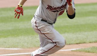 Minnesota Twins' Chris Colabello runs the bases after hitting a two-RBI single off Cleveland Indians starting pitcher Justin Masterson in the fifth inning of a baseball game, Thursday, May 8, 2014, in Cleveland. Brian Dozier and Danny Santana scored. (AP Photo/Tony Dejak)