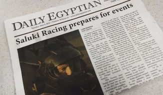 """A May 6, 2014 edition of the Daily Egyptian, the student newspaper at Southern Illinois University is seen in Carbondale, Ill., Thursday, May 8. The future of the 98-year-old paper is cloudy after the SIU Board of Trustees on Thursday, May 8, 2014, declined to approve a proposed student fee to help pay for the daily that administrators of the paper say would help keep the newspaper from losing a projected $200,000. The campus' journalism school director, Bill Freivogel, says publishing the newspaper could be """"very hard"""" without additional revenue sources. (AP Photo/The Southern)"""