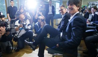 Coach of German national soccer team Joachim Loew waits for the beginning of a press conference where he presented his preliminary team for the upcoming World Cup in Brazil in Frankfurt, Germany, Thursday, May 8, 2014. (AP Photo/Michael Probst)