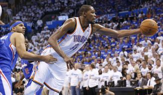 Oklahoma City Thunder forward Kevin Durant (35) is fouled by Los Angeles Clippers forward Jared Dudley (9) in the third quarter of Game 2 of the Western Conference semifinal NBA basketball playoff series in Oklahoma City, Wednesday, May 7, 2014. Oklahoma City won 112-101. (AP Photo/Sue Ogrocki)