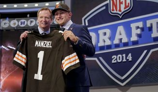 Texas A&M quarterback Johnny Manziel poses with NFL commissioner Roger Goodell after being selected by the Cleveland Browns as the 22nd pick in the first round of the 2014 NFL Draft, Thursday, May 8, 2014, in New York. (AP Photo/Craig Ruttle)