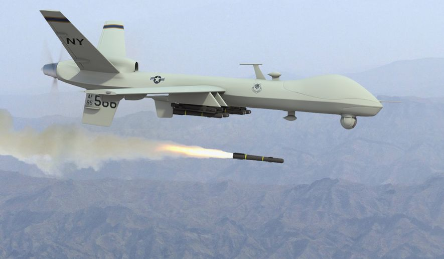 MQ-9 Reaper drone fires a missile. (Associated Press) ** FILE **