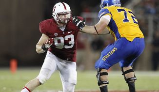 FILE - In this Sept. 7, 2013, file photo, Stanford linebacker Trent Murphy (93) rushes the quarterback against San Jose State offensive tackle Wes Schweitzer (72) during the second half of an NCAA college football game in Stanford, Calif. The Washington Redskins have opened their NFL draft by selecting linebacker Murphy in the second round. Murphy was taken Friday, May 9, 2014, at No. 47 overall. (AP Photo/Tony Avelar, File)