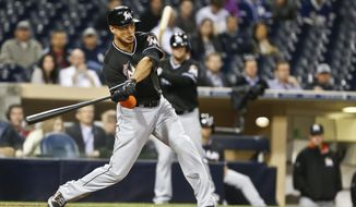 Miami Marlins' Giancarlo Stanton connects for his 11th home run of the season in the 11th inning against the San Diego Padres in  a baseball game Thursday, May 8, 2014, in San Diego. The two-run homer came after a two out error by Padres' second baseman Jedd Gyorko. (AP Photo/Lenny Ignelzi)