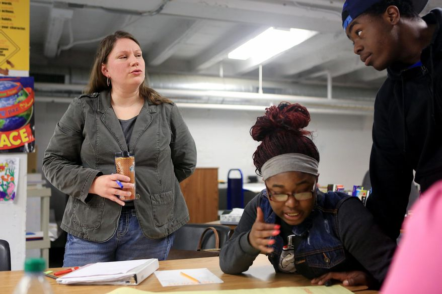 ** FILE ** In this April 11, 2014, photo, MERC Alternative High School teacher Becky Clark challenges a student with a question during a Teen Outreach Program lesson at MERC in Minneapolis. Sex education is part of the curriculum in every Minnesota high school. But 32 Hennepin County schools are expanding on the effort through the outreach program, known as TOP, which includes frank discussions on the biology of reproduction and also on healthy relationships. (AP Photo/Minnesota Public Radio, Jeffrey Thompson)