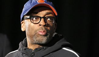 FILE - This April 29, 2014 file photo shows filmmaker and avid basketball fan Spike Lee at a news conference by NBA Commissioner Adam Silver in New York announcing that Los Angeles Clippers owner Donald Sterling has been banned for life by the league. (AP Photo/Kathy Willens, FIle)