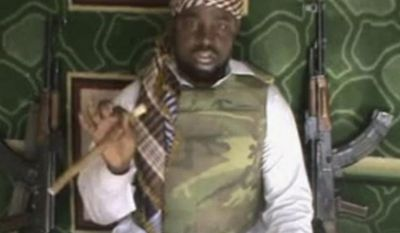 FILE - This file image made available Wednesday, Jan. 10, 2012, taken from video posted by Boko Haram sympathizers, shows the leader of the radical Islamist sect Imam Abubakar Shekau. Boko Haram has claimed responsibility for the April 15, 2014, mass abduction of nearly 300 teenage schoolgirls in northeast Nigeria. Even before the kidnapping, the U.S. government was offering up to a $7 million reward for information leading to the arrest of Shekau, whom the U.S. has labeled a specially designated global terrorist. (AP Photo/File)