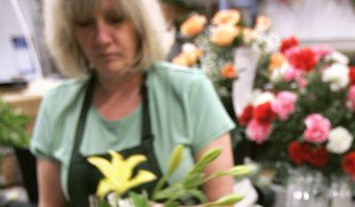 Beth Durkin makes Mother's Day flower arrangements on May 6 at a Little Rock, Ark., florist shop. (Associated Press)