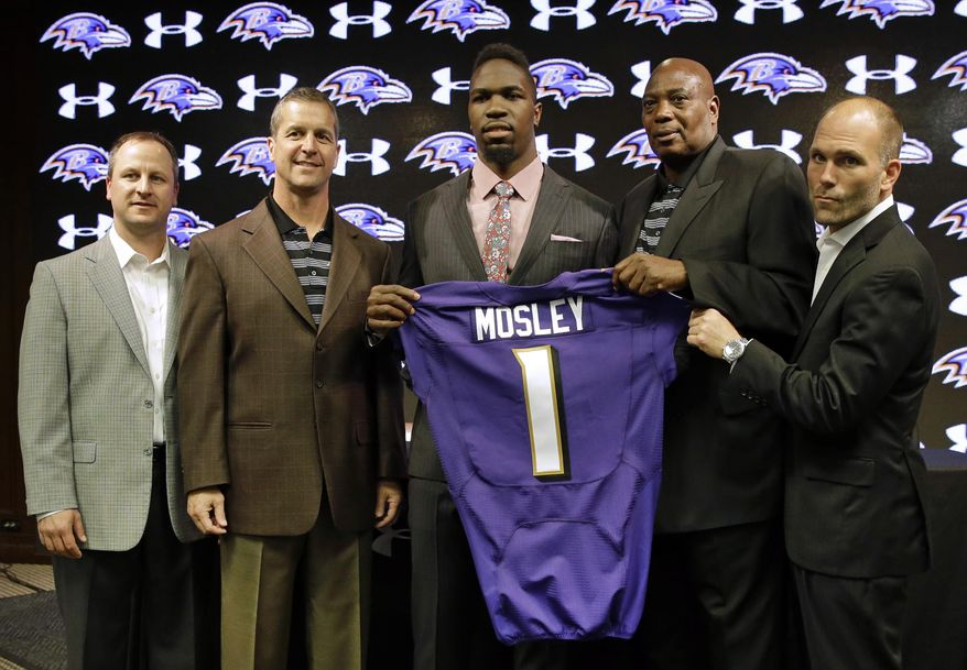 Linebacker C.J. Mosley, center, the Baltimore Ravens' first-round draft pick, poses with, from left, director of college scouting Joe Hortiz, head coach John Harbaugh, general manager Ozzie Newsome and assistant general manager Eric DeCosta before an NFL football news conference, Friday, May 9, 2014, at the team's practice facility in Owings Mills, Md. Mosley was selected 17th overall in Thursday night's draft. (AP Photo/Patrick Semansky)