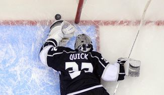 Los Angeles Kings goalie Jonathan Quick reaches for the puck aftar being scored on by Anaheim Ducks right wing Teemu Selanne, of Finland, during the third period in Game 3 of an NHL hockey second-round Stanley Cup playoff series, Thursday, May 8, 2014, in Los Angeles. The Ducks won 3-2. (AP Photo/Mark J. Terrill)