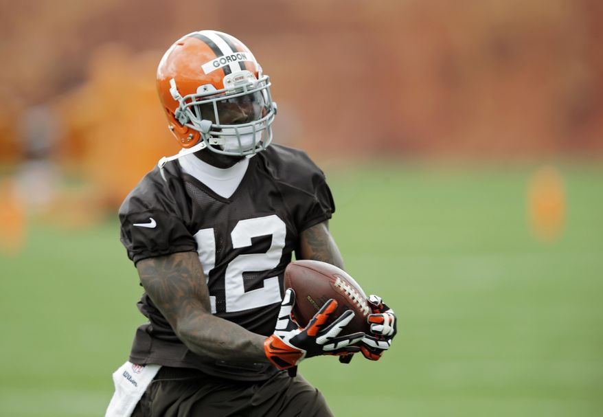 FILE - In this May 1, 2014, file photo, Cleveland Browns wide receiver Josh Gordon makes a catch during a voluntary minicamp workout at the NFL football team's facility in Berea, Ohio. As the second round of the NFL draft was set to open Friday, May 9, ESPN reported that Gordon, who led the NFL in yards receiving last season, had failed another drug test for marijuana and could be banned for a year. The ESPN report, based on anonymous sources, described letters the Pro Bowler received about the failed test. (AP Photo/Mark Duncan, File)