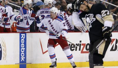 New York Rangers' Ryan McDonagh, center, celebrates with teammates as he returns to the bench after his goal in the second period of Game 5 of a second-round NHL playoff hockey series as Pittsburgh Penguins' Craig Adams (27) heads back to his bench in Pittsburgh, Friday, May 9, 2014. (AP Photo/Gene J. Puskar)