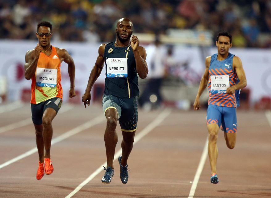 Lashawn Merritt of the USA, center, wins the 400m at the IAAF Diamond League in the Qatari capital Doha, Friday May 9, 2014. (AP Photo/Osama Faisal)