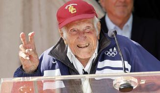 Louis Zamperini gestures during a news conference Friday May 9, 2014 in Pasadena, Calif. Ninety-seven-year-old World War II hero and former Olympian, Zamperini has been named grand marshal of the 2015 Rose Parade.(AP Photo/Nick Ut)