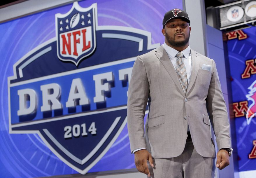 Minnesota defensive tackle Ra'Shede Hageman poses for photos after being selected by the Atlanta Falcons as the 37th pick during the second round of the 2014 NFL Draft, Friday, May 9, 2014, in New York. (AP Photo/Jason DeCrow)