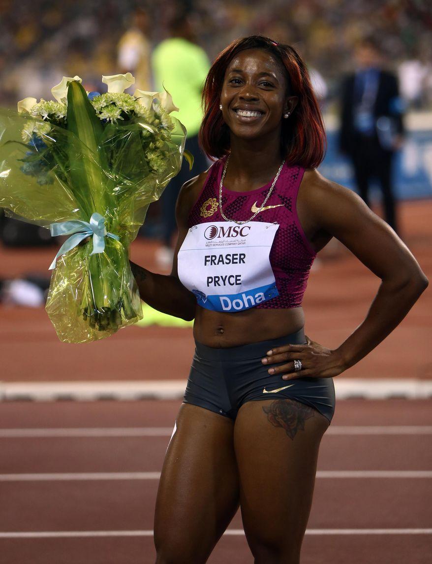 Shelly-Ann Fraser-Pryce of Jamaica wins the women's 100m at the IAAF Diamond League in the Qatari capital Doha, Friday May 9, 2014. (AP Photo/ Osama Faisal)