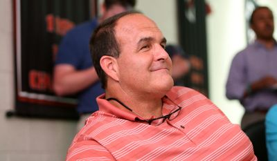 NFL Hall of Fame offensive lineman Bruce Matthews listens to his son's NFL news conference at the Atlanta Falcons' headquarters Friday, May 9, 2014, in Flowery Branch, Ga. Matthews' son Jake Matthews, an offensive lineman from Texas A&M, was the selected sixth overall in Thursday's NFL draft. (AP Photo/Jason Getz)
