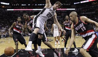 San Antonio Spurs' Tiago Splitter (22), of Brazil, loses control of the ball as Portland Trail Blazers' LaMarcus Aldridge, second from left, and Nicolas Batum (88) pressure him during the second half of Game 2 of a Western Conference semifinal NBA basketball playoff series, Thursday, May 8, 2014, in San Antonio. San Antonio won 114-97.  (AP Photo/Eric Gay)