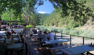 Galice Resort, shown here alongside the Rogue River's recreation section near Grants Pass, Ore., in this undated photo, is a popular spot for rafters after a long day on the river and has live music many nights. The outdoor recreation calendar in southeast Oregon lasts from May into October and with wild rivers, rugged mountains and great fishing, it makes a wonderful place for family vacations. (AP Photo,Statesman Journal, Zach Urness)