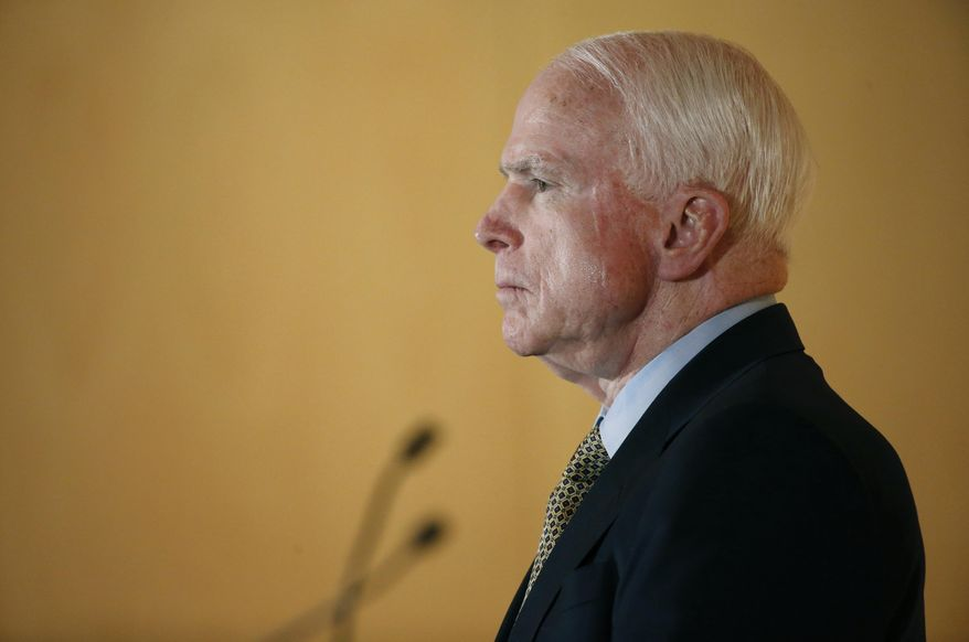 Sen. John McCain listens to complaints from veterans during a forum with veterans on Friday, May 9, 2014, in Phoenix. McCain was discussing lapses in care at the Phoenix Veterans Affairs hospital that prompted a national review of operations around the country. (AP Photo/Matt York)
