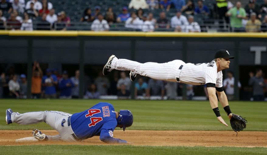 Chicago White Sox second baseman Gordon Beckham, right, turns the double play getting Chicago Cubs' Anthony Rizzo at second and Starlin Castro at first, during the first inning of an interleague baseball game Thursday, May 8, 2014, in Chicago. (AP Photo/Charles Rex Arbogast)