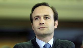 FILE--In a Feb. 7, 2013 file photo Michigan Lt. Gov. Brian Calley is shown before the state Legislature in Lansing, Mich. Wes Nakagiri of Livingston County's Hartland Township plans to challenge Lt. Gov. Brian Calley in 2014 to protest policies of Republican Gov. Rick Snyder. (AP Photo/Carlos Osorio, File)