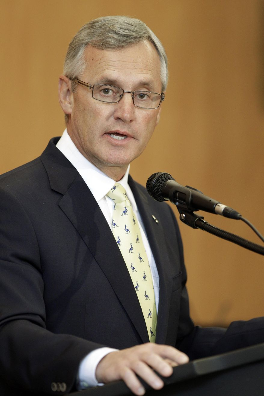 FILE - In this Thursday, Feb. 2, 2012 file photo, former Ohio State football coach Jim Tressel speaks after being introduced as the new vice president for strategic engagement at the University of Akron in Akron, Oho. A spokesman says trustees at Youngstown State University voted Friday, May 9, 2014 to offer the president's job to Tressel. Tressel is one of three finalists for the job at the northeastern Ohio school where he started his college coaching career. Youngstown State spokesman Ron Cole said Friday, May 9, 2014 that a contract is being negotiated. Tressel was chosen over the president of Southern Oregon University and the chancellor of the University of North Carolina Wilmington. (AP Photo/Mark Duncan, File)