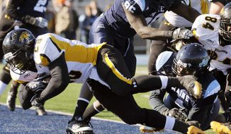 Towson running back Terrence West (28) scores in the first half of an NCAA football game agianst Maine, in Orono, Maine. Saturday, Nov. 5, 2011. (AP Photo/Michael C. York)