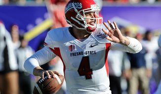 Fresno State quarterback Derek Carr looks to throw the ball against Southern California during the second quarter of the Royal Purple Bowl NCAA college football game, Saturday, Dec. 21, 2013, in Las Vegas. (AP Photo/David Cleveland)