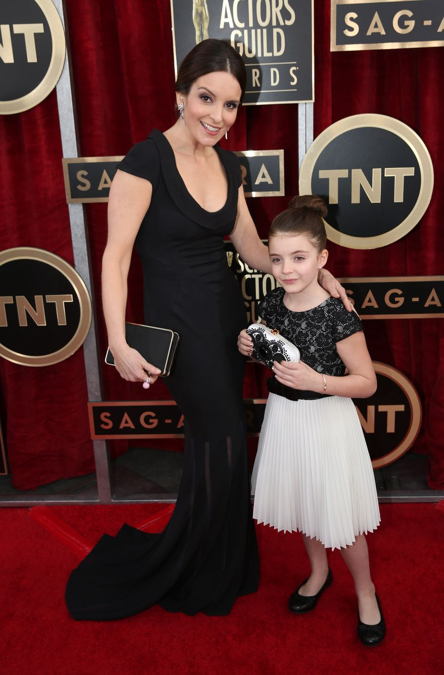 Tina Fey and her daughter Alice Zenobia Richmond arrive at the 20th annual Screen Actors Guild Awards at the Shrine Auditorium on Saturday, Jan. 18, 2014, in Los Angeles. (Photo by Matt Sayles/Invision/AP)