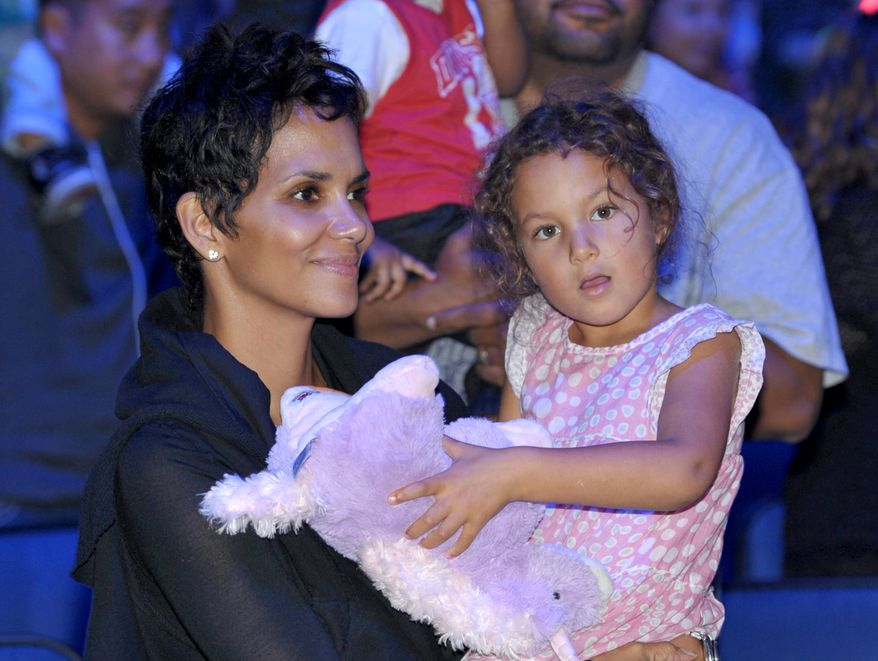 Halle Berry, left, and daughter Nahla Aubry attend Yo Gabba Gabba! Live!: Get The Sillies Out! 50+ city tour kick-off performance on Thanksgiving weekend at Nokia Theatre L.A. Live on Friday Nov. 23, 2012 in Los Angeles. (Photo by John Shearer/Invision for GabbaCaDabra, LLC./AP Images)