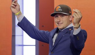 Texas A&M quarterback Johnny Manziel reacts after being selected by the Cleveland Browns as the 22nd pick in the first round of the 2014 NFL Draft, Thursday, May 8, 2014, in New York. (AP Photo/Frank Franklin II)