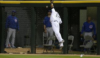 Chicago White Sox right fielder Moises Sierra is unable to catch a long fly ball off the bat of Chicago Cubs' Anthony Rizzo during the eighth inning of an interleague baseball game Thursday, May 8, 2014, in Chicago. (AP Photo/Charles Rex Arbogast)