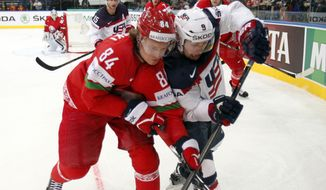 USA forward Tyler Johnson, right, is challenged by Belarus forward Mikhail Grabovski, during the Group B preliminary round match between Belarus and USA at the Ice Hockey World Championship in Minsk, Belarus, Friday, May 9, 2014. (AP Photo/Darko Bandic)